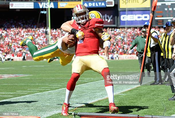 Clay Matthews of the Green Bay Packes tackles Colin Kaepernick of the San Francisco 49ers late out of bounds during the second quarter at Candlestick...
