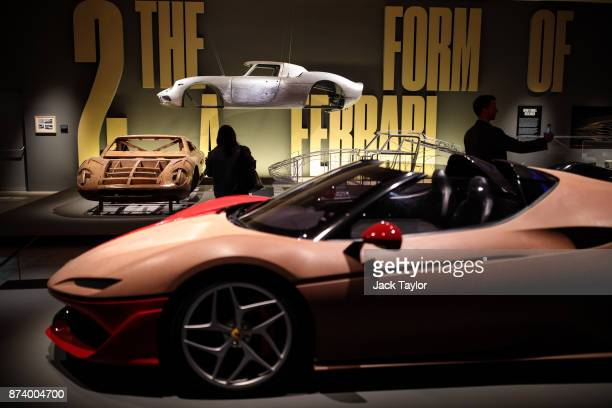 Clay Model of Ferrari J50 2015 and a wooden model of the Ferrari 365 P by Pininfarina 1966 on display at the 'Ferrari Under the Skin' exhibition at...