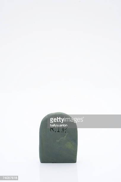 clay model tombstone, white background - rest in peace stock photos and pictures