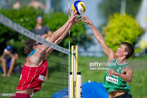 Clay Paullin of USA attacks Runar Torsvik Sannarnes of Norway during FIVB Under 23 World Championships on June 10, 2014 in Myslowice, Poland.