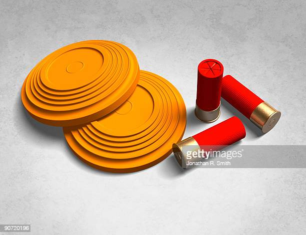 clay pigeons and shotgun shells - clay pigeon shooting stock pictures, royalty-free photos & images