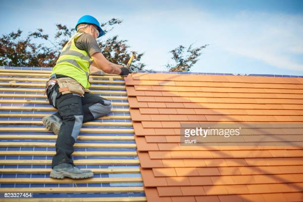clay plain tiled roof installation - roof tile stock pictures, royalty-free photos & images