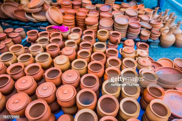 Clay pots and bowls on floor