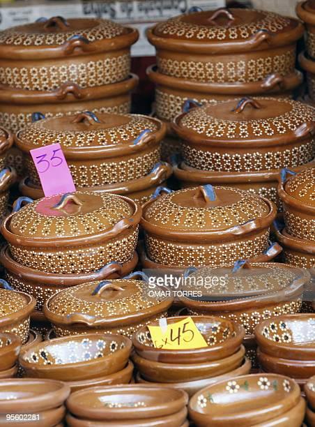 Clay pots for sell 01 October 2007 at the Mole Fair in San Pedro Atocpan near Mexico City's inner limits The mole a sauce of prehispanic origin made...