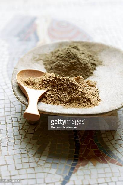 Clay powder for spa treatment on mosaic background
