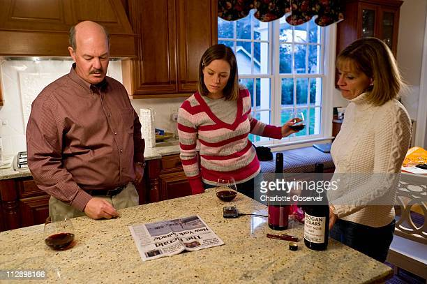 Clay Presley describes the scene on the wing of the ditched US Airways Airbus 320 to his daughter Sara and his wife Carol in the family's kitchen in...