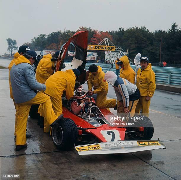 Clay Regazzoni of Switzerland driver of the Scuderia Ferrari SpA Ferrari 312T Ferrari Flat12 talks to his mechanics during the wet practice for the...