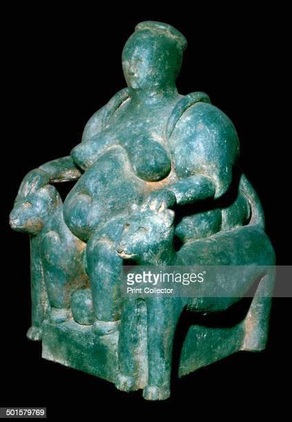 Clay sculpture of a mothergoddess from Catal Huyuk Turkey on a leopard throne giving birth