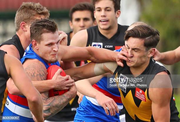 Clay Smith of the Bulldogs is tackled during the 2017 VFL round 10 match between the Footscray Bulldogs and the Werribee Tigers at Whitten Oval on...