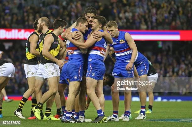 Clay Smith of the Bulldogs Tom Boyd of the Bulldogs Lachie Hunter of the Bulldogs and Tom Liberatore of the Bulldogs celebrate at the final siren and...
