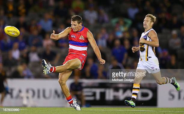 Clay Smith of the Western Bulldogs kicks a super goal during round two NAB Cup AFL match between the Western Bulldogs and the Hawthorn Hawks at...