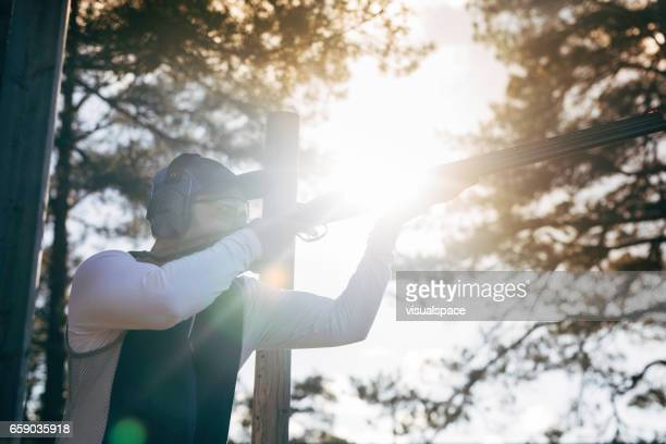 Clay target shooter in sunset