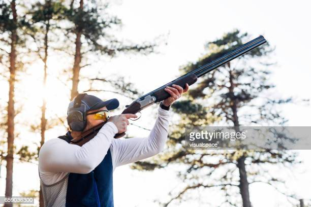 clay target shooter - trap shooting stock pictures, royalty-free photos & images