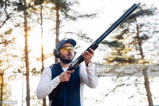 clay target shooter - clay pigeon shooting stock pictures, royalty-free photos & images