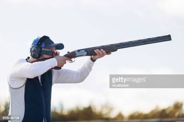 clay target shooter - shotgun stock pictures, royalty-free photos & images