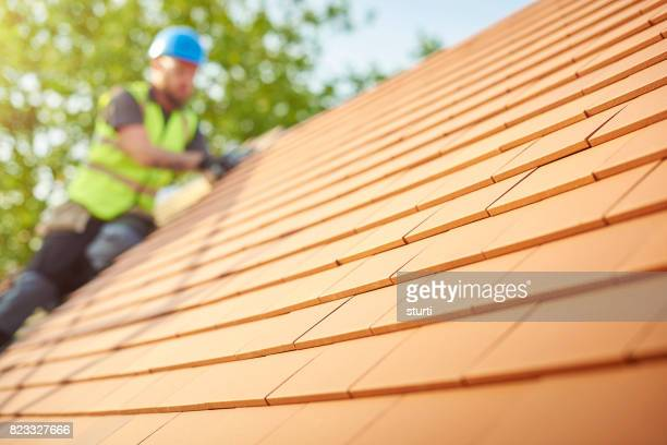 clay tiled roof installation - roof tile stock pictures, royalty-free photos & images