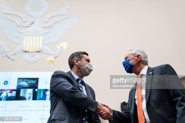 Clay Travis, founder of sports media company Outkick, is greeted by Rep. Ken Buck before the start of a House Judiciary Subcommittee on Antitrust,...