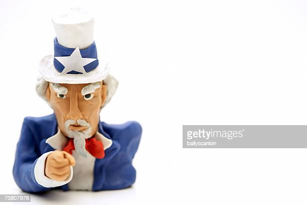 Clay Uncle Sam figurine against white background, close-up