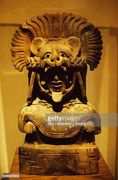 Clay urn depicting a character with jaguarshaped helmet from Monte Alban Mixtec and Zapotec civilisations Oaxaca Museo De Las Culturas De Oaxaca