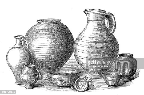 Clay vessels from the Roman period from the left a bottle drinking cup an urn a bowl a small clay lamp a large jug cupshaped jar and a mug Germany...