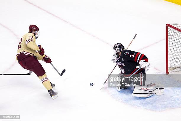 Clay Witt of the Northeastern University Huskies stops Kevin Hayes of the Boston College Eagles on a breakaway during NCAA hockey action in the...
