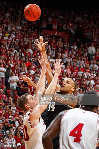 Claybrin McMath of the Bryant Bulldogs shoots the ball against Cody Zeller of the Indiana Hoosiers during the game at Assembly Hall on November 9...