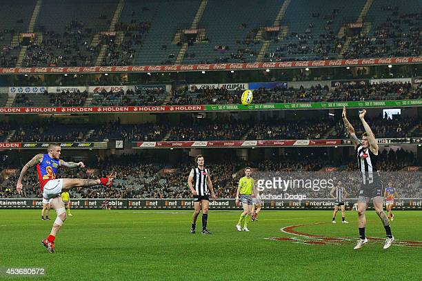 Claye Beams of the Lions kicks the ball over brother Dayne Beams of the Magpies during the round 21 AFL match between the Collingwood Magpies and the...