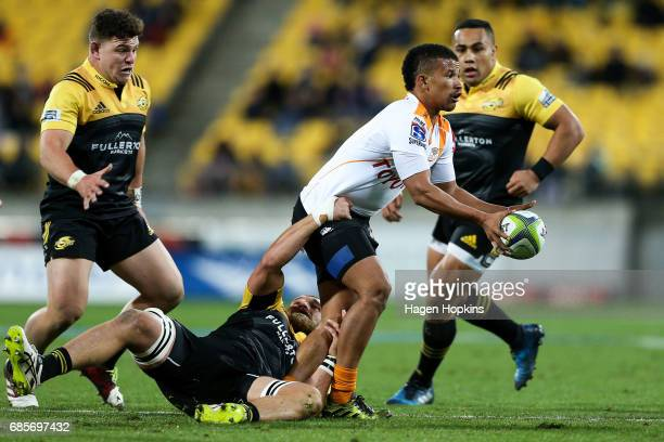 Clayton Blommetjies of the Cheetahs is tackled by Brad Shields of the Hurricanes during the round 13 Super Rugby match between the Hurricanes and the...