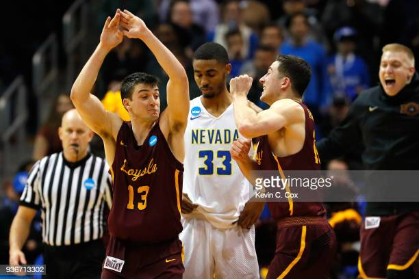 Clayton Custer and Ben Richardson of the Loyola Ramblers celebrate after defeating the Nevada Wolf Pack during the 2018 NCAA Men's Basketball...