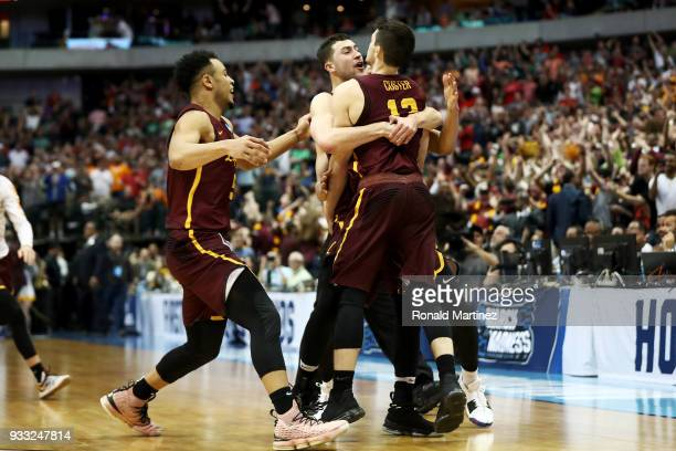 Clayton Custer of the Loyola Ramblers is mobbed by teammates after hitting the game-winning shot to beat the Tennessee Volunteers 63-62 in the second...