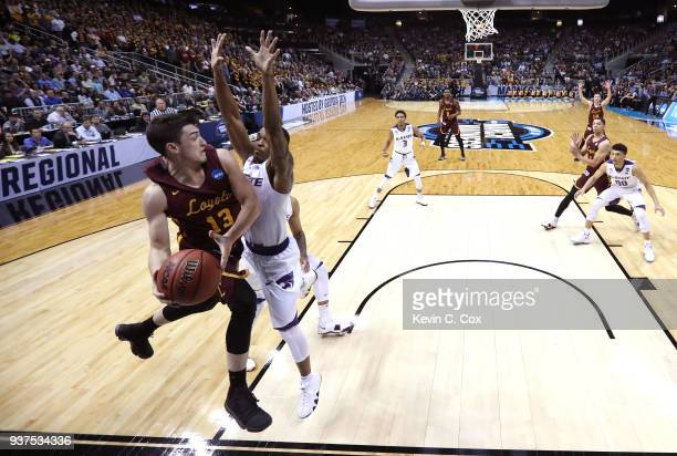 Clayton Custer of the Loyola Ramblers looks to pass in the first half against Barry Brown of the Kansas State Wildcats during the 2018 NCAA Men's...