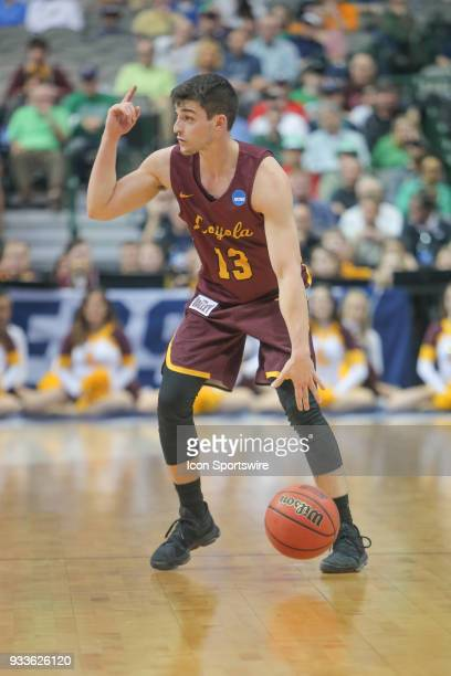 Clayton Custer of the LoyolaChicago Ramblers sets the play during the NCAA Div I Men's Championship Second Round basketball game between...