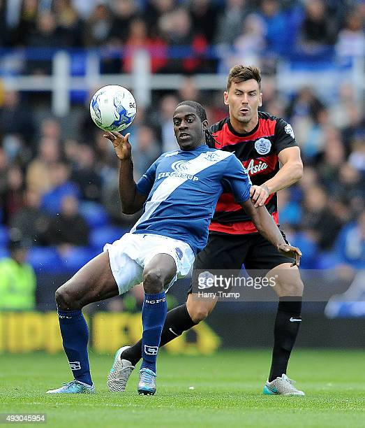 Clayton Donaldson of Birmingham City is tackled by Grant Hall of Queens Park Rangers during the Sky Bet Championship match between Birmingham City...