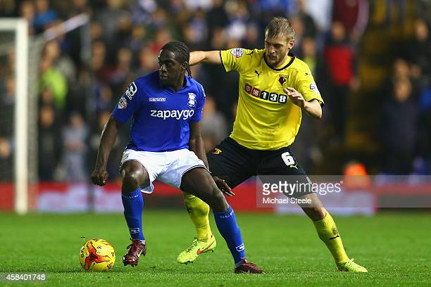 Clayton Donaldson of Birmingham City is tracked by Joel Ekstrand of Watford during the Sky Bet Championship match between Birmingham City and Watford...