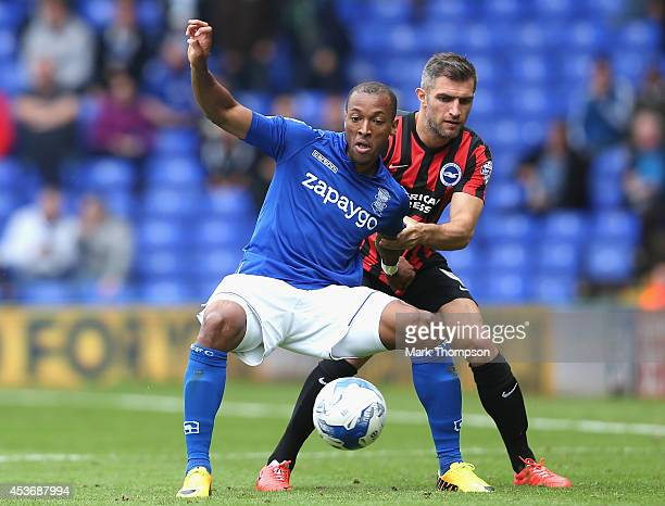 Clayton Donaldson of Birmingham City tangles with Aaron Hughes of Brighton Hove Albion during the Sky Bet Championship match between Birmingham City...