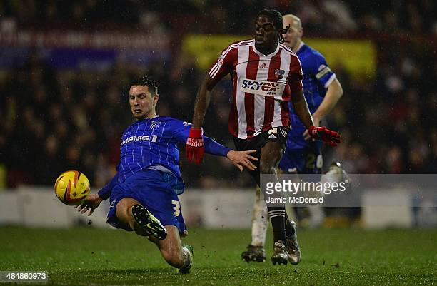 Clayton Donaldson of Brentford battles with Joe Martin of Gillingham during the Sky Bet League One match between Brentford and Gillingham at Griffin...