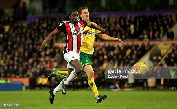 Clayton Donaldson of Sheffield United and Christoph Zimmermann of Norwich City compete for the ball during the Sky Bet Championship match between...