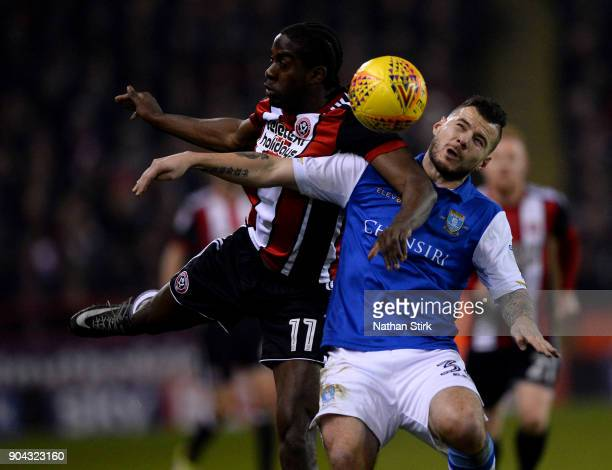 Clayton Donaldson of Sheffield United and Daniel Pudil of Sheffield Wednesday in action during the Sky Bet Championship match between Sheffield...