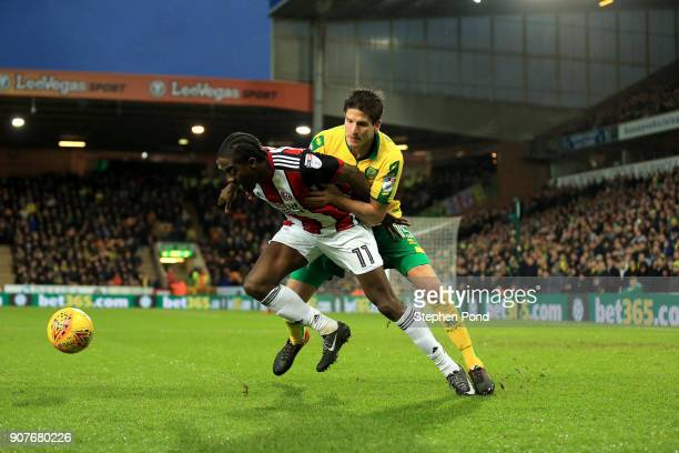 Clayton Donaldson of Sheffield United and Timm Klose of Norwich City compete for the ball during the Sky Bet Championship match between Norwich City...