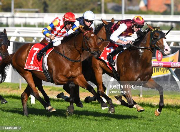 Clayton Douglas riding Streets of Avalon defeats Dwayne Dunn riding Manolo Blahniq in Race 7 Ladbrokes Victoria Handicap during the Easter Cup Races...