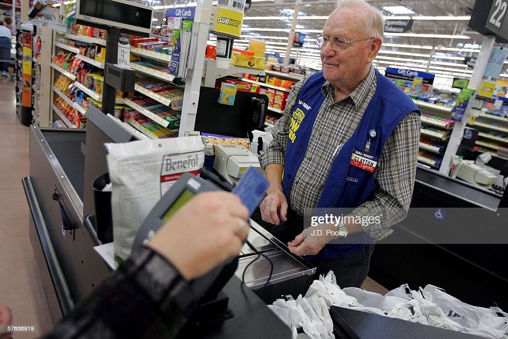 Clayton Fackler, 72, works at the check out at the new 2,000 square foot Wal-Mart Supercenter store May 17, 2006 in Bowling Green, Ohio. The new store, one of three new supercenters opening today in Ohio, employs 340 people with 60 percent of those working full-time.