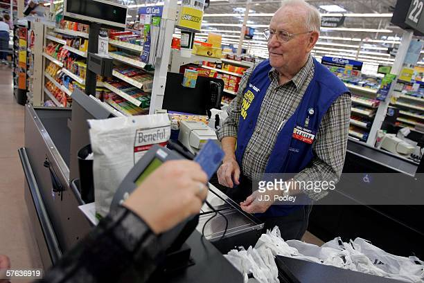 Clayton Fackler works at the check out at the new 2000 square foot WalMart Supercenter store May 17 2006 in Bowling Green Ohio The new store one of...