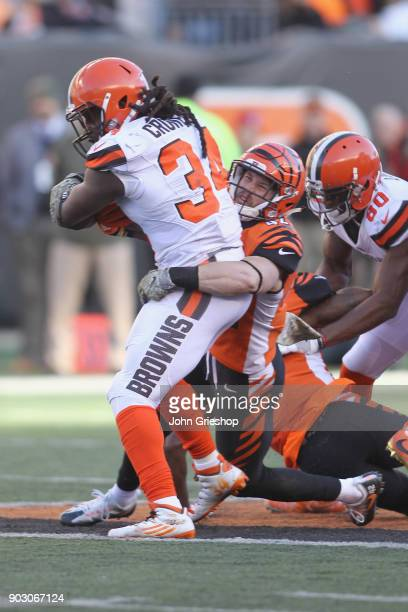 Clayton Fejedelem of the Cincinnati Bengals makes the hit on Isaiah Crowell of the Cleveland Browns during their game at Paul Brown Stadium on...