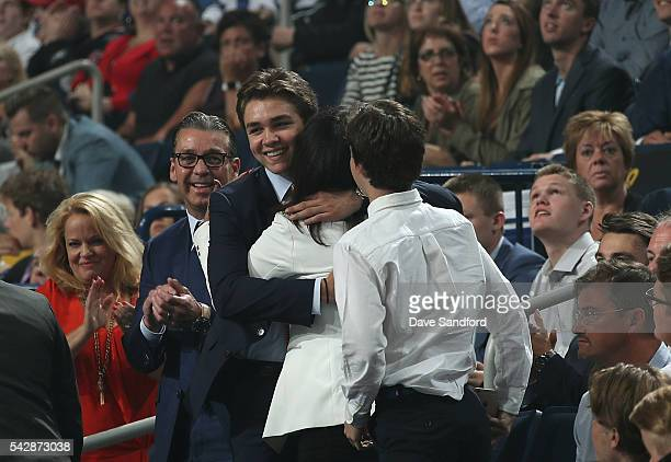 Clayton Keller celebrates in the stands with his family after being selected seventh overall by the Arizona Coyotes during round one of the 2016 NHL...