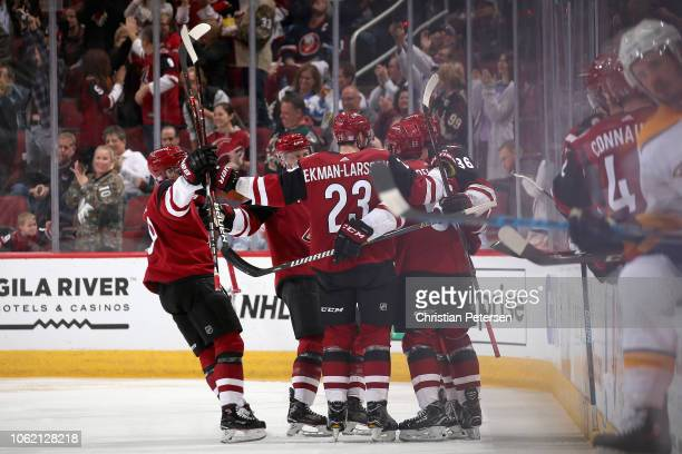 Clayton Keller Derek Stepan Oliver EkmanLarsson Christian Fischer and Jason Demers of the Arizona Coyotes celebrate after Demers scored a goal...
