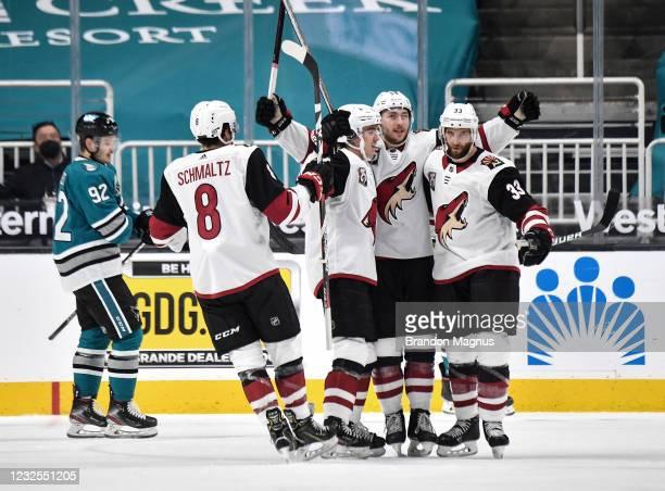 Clayton Keller Nick Schmaltz, Alex Goligoski and Michael Bunting of the Arizona Coyotes celebrate scoring a goal against the San Jose Sharks at SAP...
