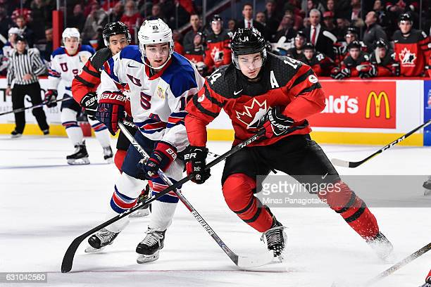 Clayton Keller of Team United States and Mathew Barzal of Team Canada skate against one another during the 2017 IIHF World Junior Championship gold...