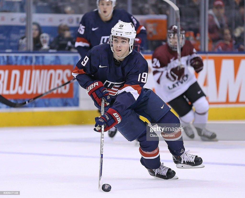 Clayton Keller #19 of Team USA skates with the puck against Team Latvia during a preliminary game at the 2017 IIHF World Junior Hockey Championship at the Air Canada Centre on December 26, 2016 in Toronto, Ontario, Canada. USA defeated Latvia 6-1.