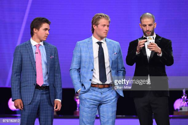 Clayton Keller of the Arizona Coyotes and Brock Boeser of the Vancouver Canucks watch illusionist Darcy Oake perform a card trick onstage during the...