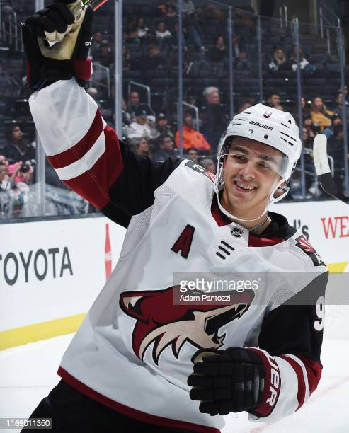 Clayton Keller of the Arizona Coyotes celebrates a second-period goal scored by Christian Dvorak during the game against the Los Angeles Kings at...
